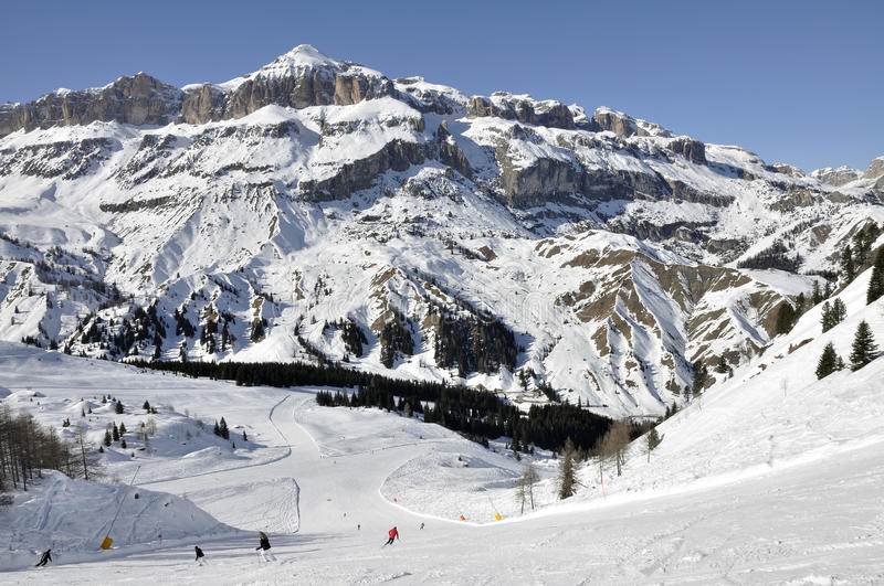 Arabba steep ski run, dolomites. View from above of steep ski run in dolomite, shot in bright winter light, in background high valley and mountains stock photos