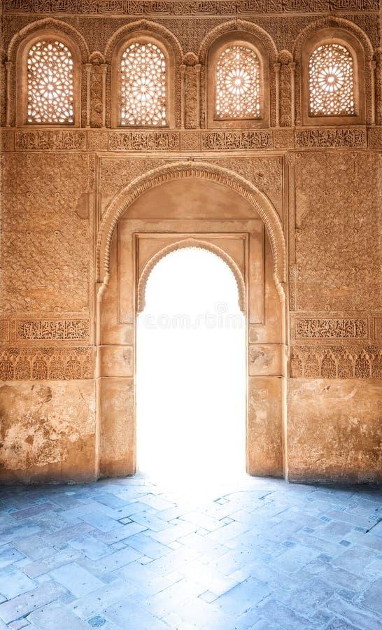 Arabesque door of Granada palace in Spain, Europe. royalty free stock image