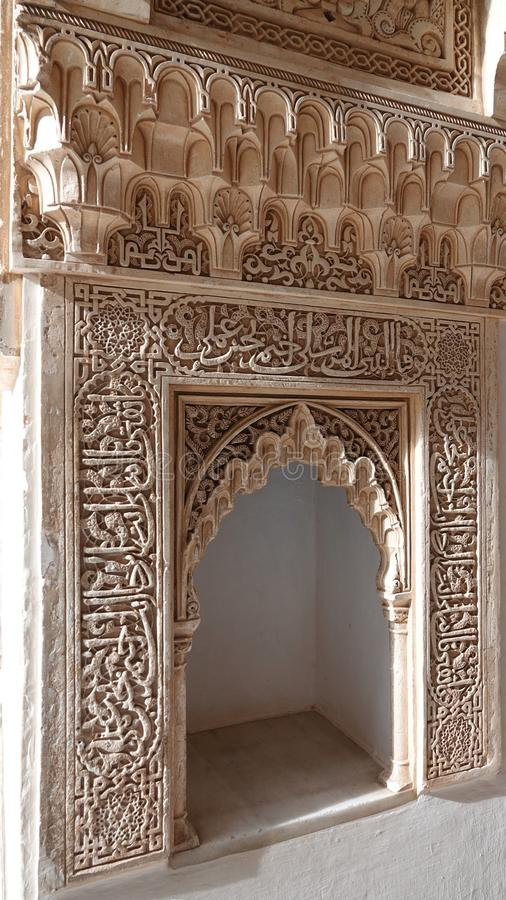 Arabesque niche at Nasrid palace of the Alhambra in Granada, Andalusia. Niche decorations with arabesque ornaments at the  Nasrid complex stock photography