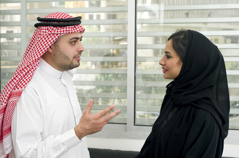 Arabian Business man having a discussion with an arabian businesswoman in the office stock image