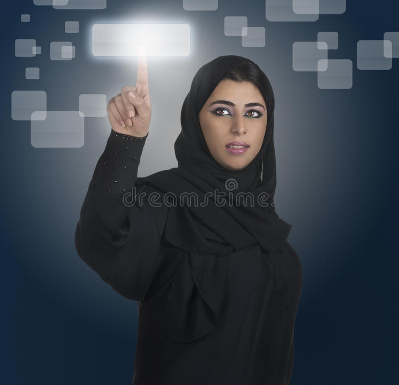 Arabian business woman pressing a touchscreen royalty free stock photos