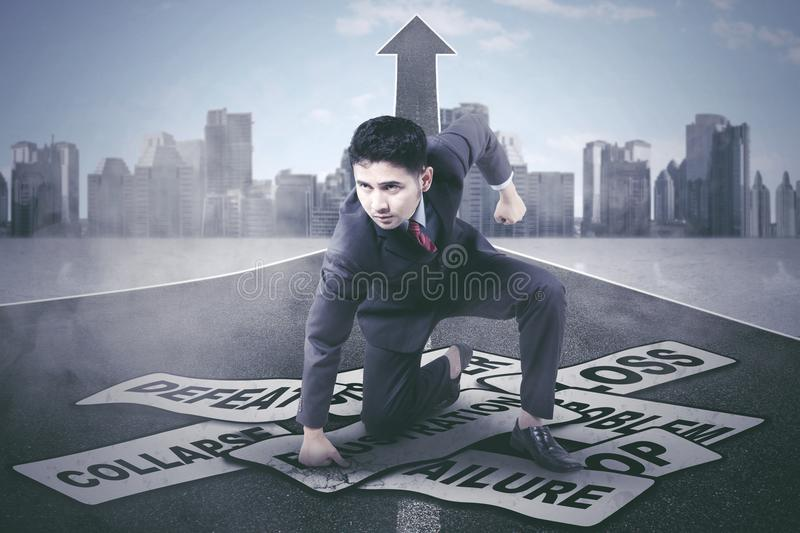 Arabian businessman defeating his problems royalty free stock images