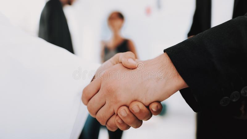Arabian Businessman Handshake With A Manager. royalty free stock image