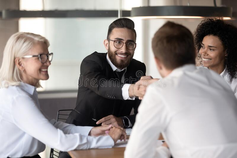 Arabian executive manager shake hands client accomplish successful negotiations stock photo