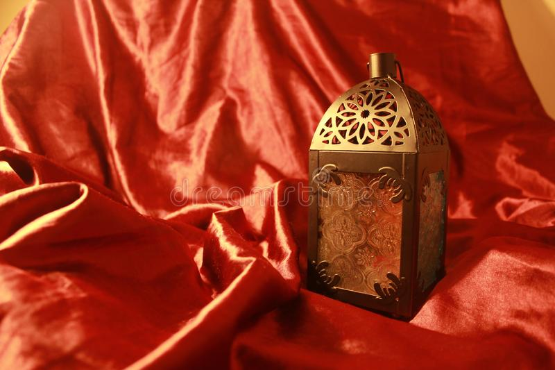 Arabian Lamp eid ramadan celebration festival with rich elegant luxurious red silk background royalty free stock photography