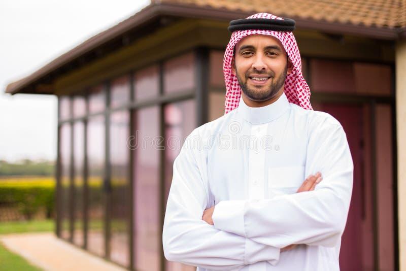 Arabian man arms crossed stock photos