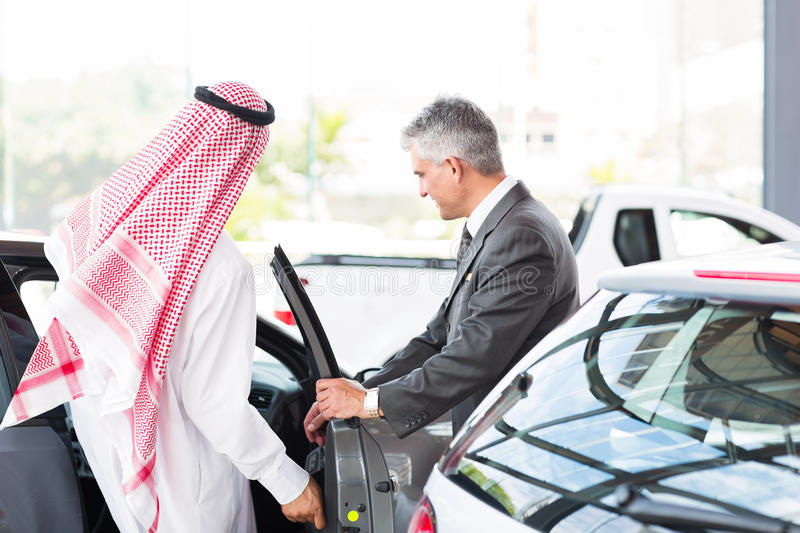 Arabian man test drive royalty free stock image