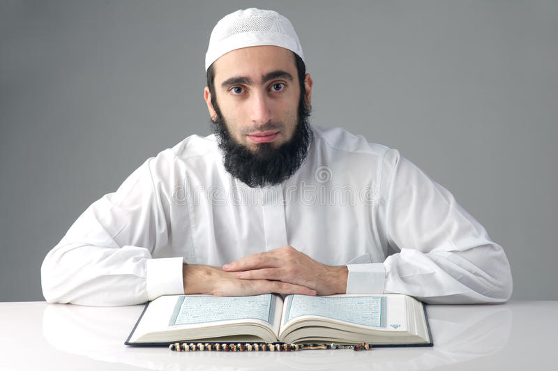Arabian muslim man reading Quran royalty free stock image