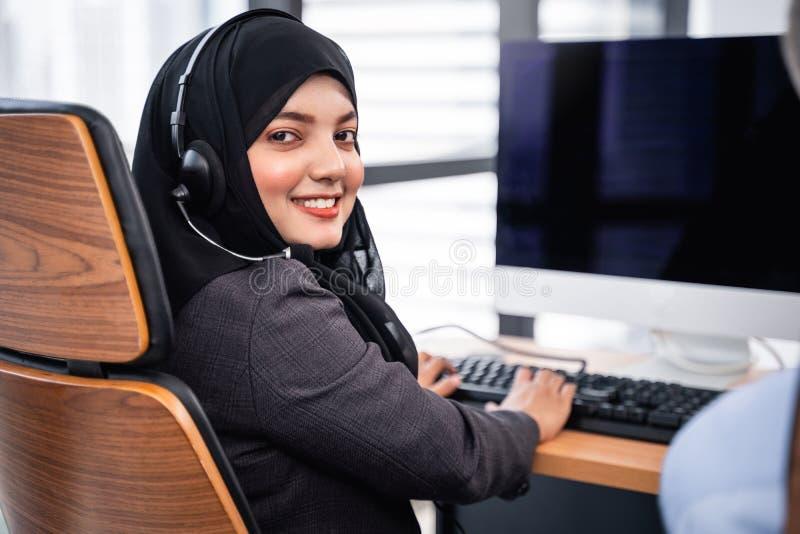 arabian-muslim-woman-works-call-center-operator-customer-service-agent-wearing-microphone-headsets-working-computer-182465100.jpg