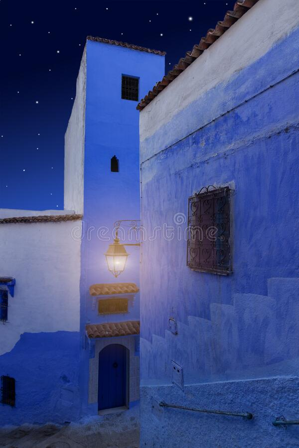 Magic Arabian Night. Arabian Night. Oriental tales. Magical night street in the blue city. Medina of Chefchaouen town, Morocco. Dreamy and romantic background royalty free stock images