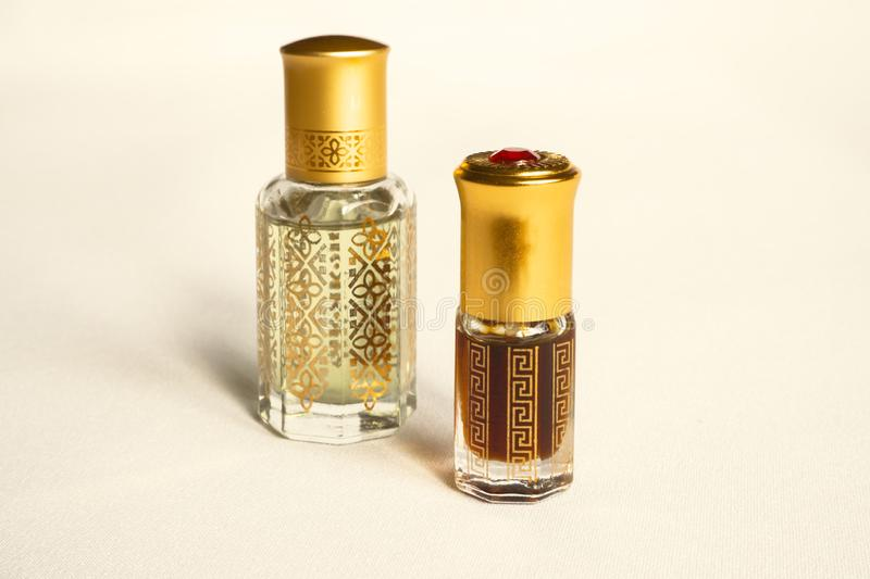Arabian oud attar perfume or agarwood oil fragrances in mini bottles. stock photography