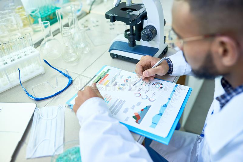 Arabian scientist analyzing research results royalty free stock photography