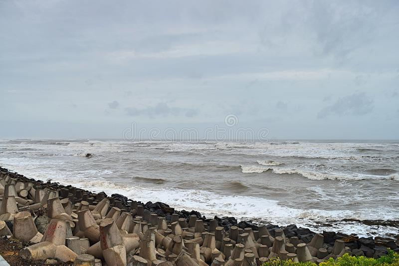 Arabian Sea or Indian Ocean with High Tide and Cloudy Sky & Rocky Beach at time of Vayu Cyclone - Devbhumi Dwarka, Gujarat, India stock photos