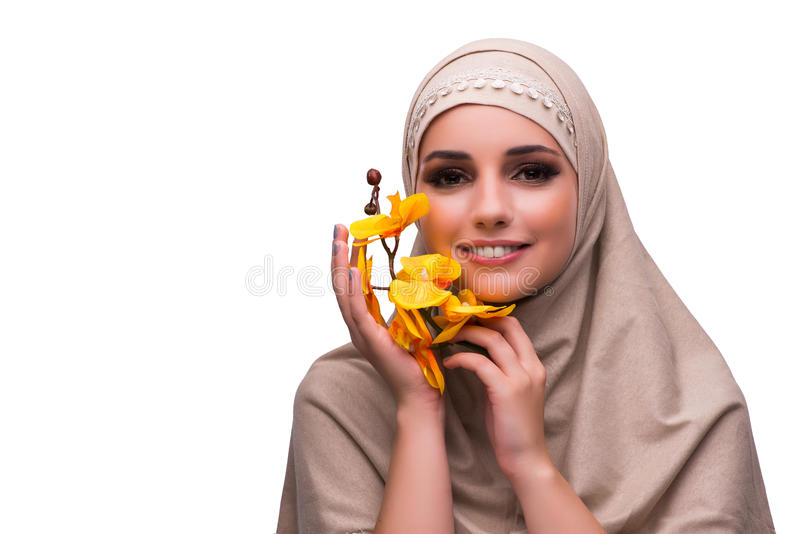 The arabian woman with orchid flower isolated on white. Arabian woman with orchid flower isolated on white royalty free stock images