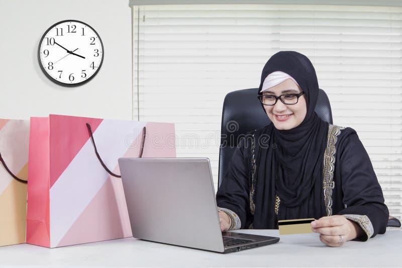 Arabian woman shopping online stock photo