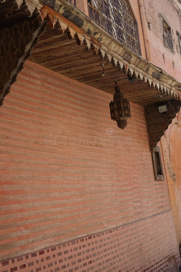 ARABIC ARCHITECTURE. MOROCCAN BUILDING IN MARRAKESH WITH EXOTIC IRON LAMP stock image