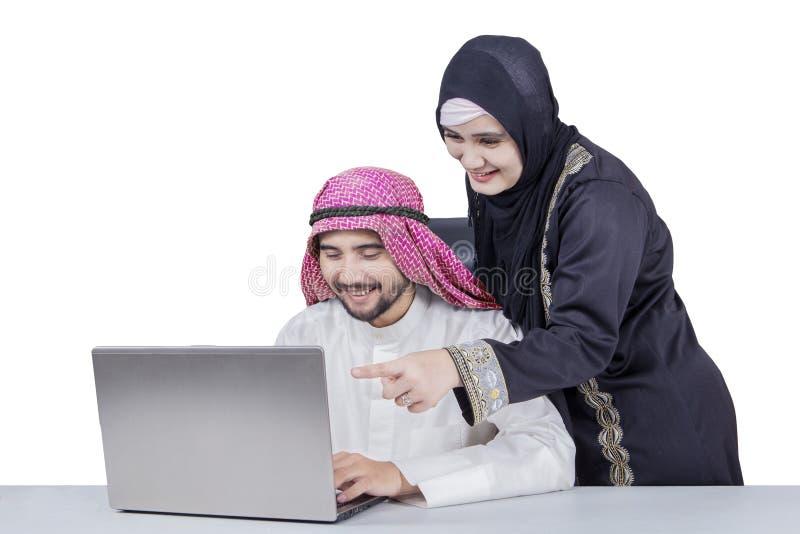Arabic businesspeople using laptop royalty free stock photo