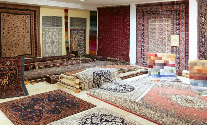 Arabic carpet shop exhibition colorful carpets stock images