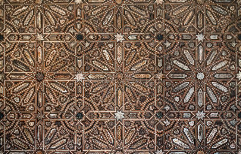 Arabic pattern wood. Arabic ceiling pattern wood. Geometric forms in Alhambra, Granada. Spain. Tile texture stock photos