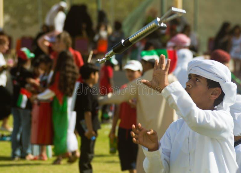 Arabic Child Throwing Gun royalty free stock photo