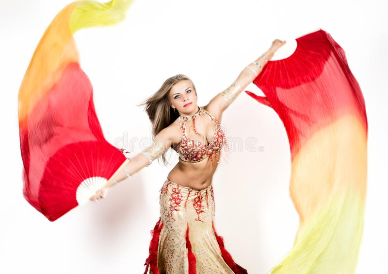 Arabic dance with fans and ribbons performed by a beautiful plump woman royalty free stock photos