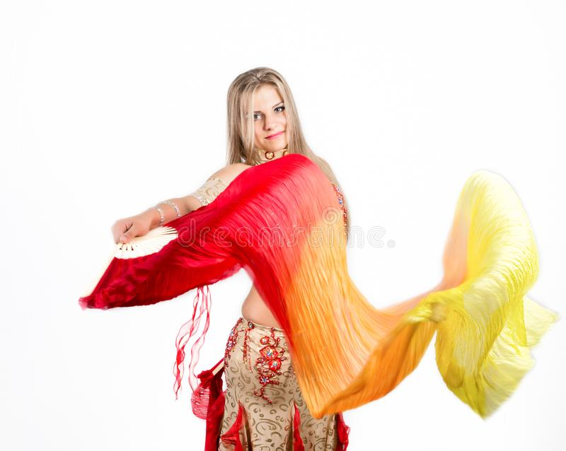 Arabic dance with fans and ribbons performed by a beautiful plump woman stock image