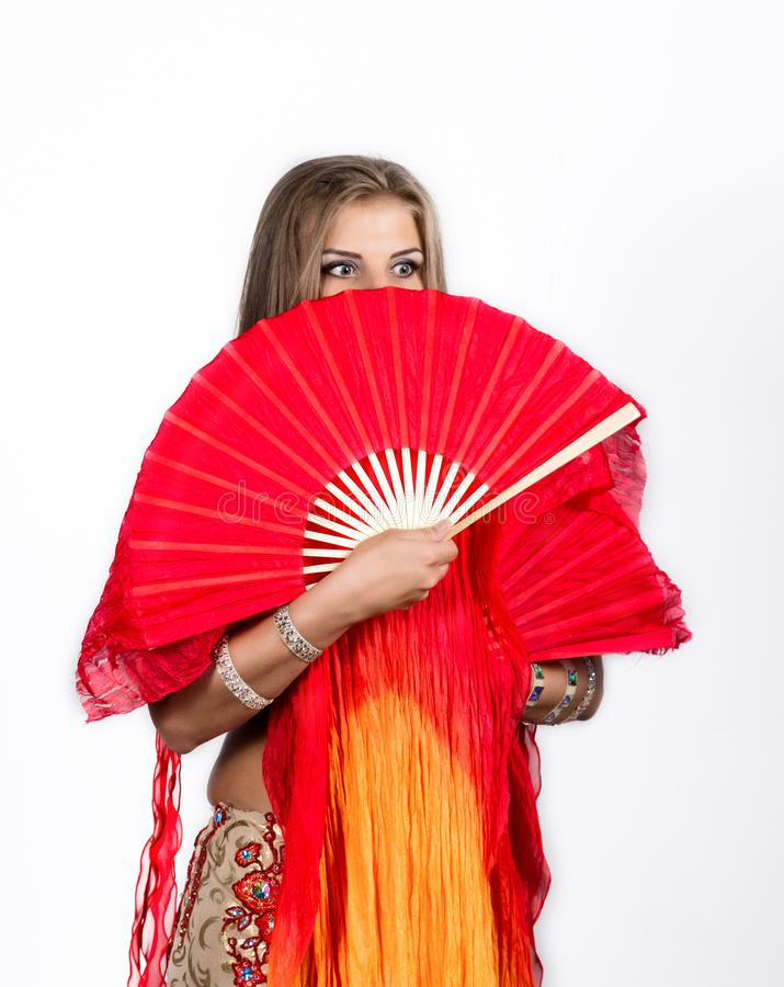 Arabic dance with fans and ribbons performed by a beautiful plump woman stock photography