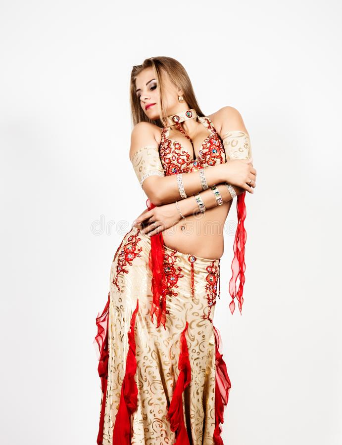 Arabic dance performed by a beautiful plump woman on a light background stock photography