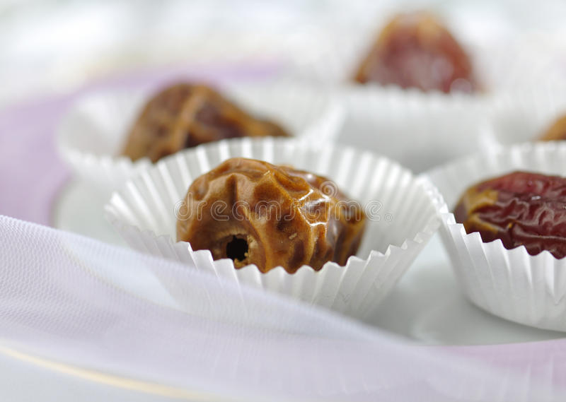Arabic dates in paper cup royalty free stock photo