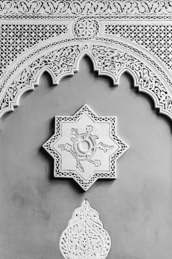 Arabic decoration of a wall with an eight-point star and a bow in the socket. Black and white image royalty free stock photography