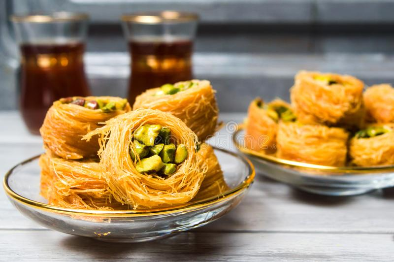 Arabic dessert with pistachio with tea royalty free stock image