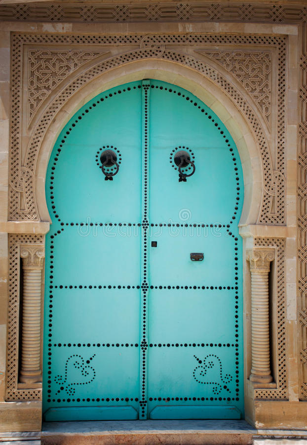 Arabic door. Blue wooden door in arabic style. Traditional arabic arhitecture royalty free stock photo