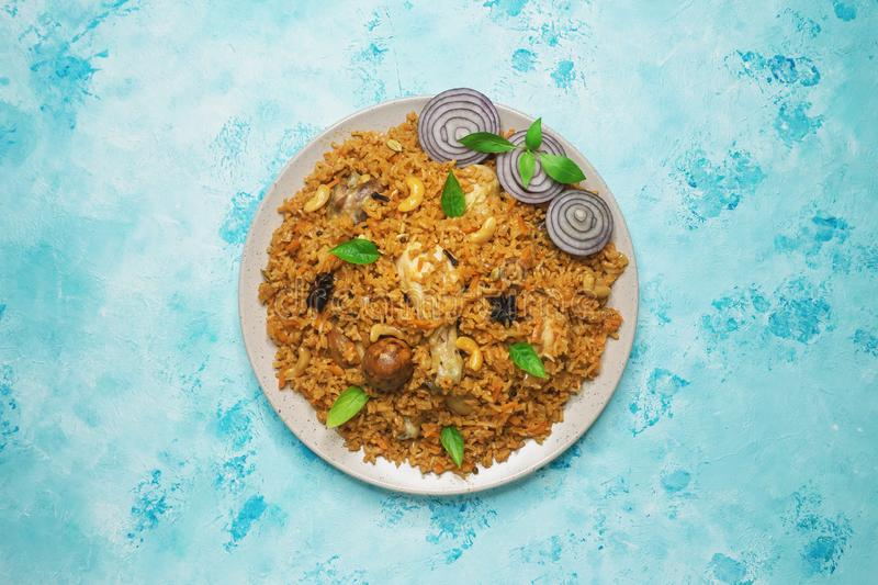 Arabic food Kabsa: chicken with rice on a plate. stock photo