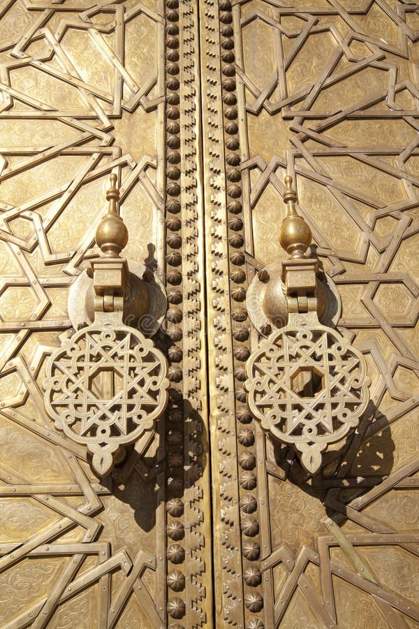 Arabic Gold craftwork. On a door in Fes in Marocco royalty free stock photography