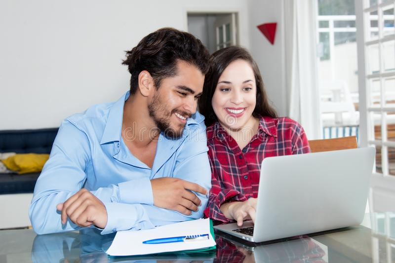 Arabic hipster men watching movie with caucasian girlfriend at c royalty free stock photos