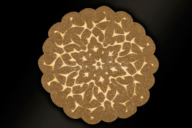Arabic And Indian Round Gold Hand Beaded And Handmade Placemats. Table Runner Home Decorations Crafted Of Luminous Glass Beads Sewn To A Satin Fabric stock photos