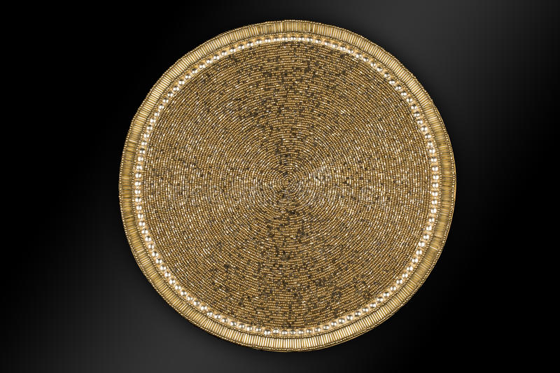 Arabic and Indian round Gold Hand Beaded and Handmade Placemats. Table runner Home Decorations crafted of luminous glass beads sewn to a satin fabric with the stock image