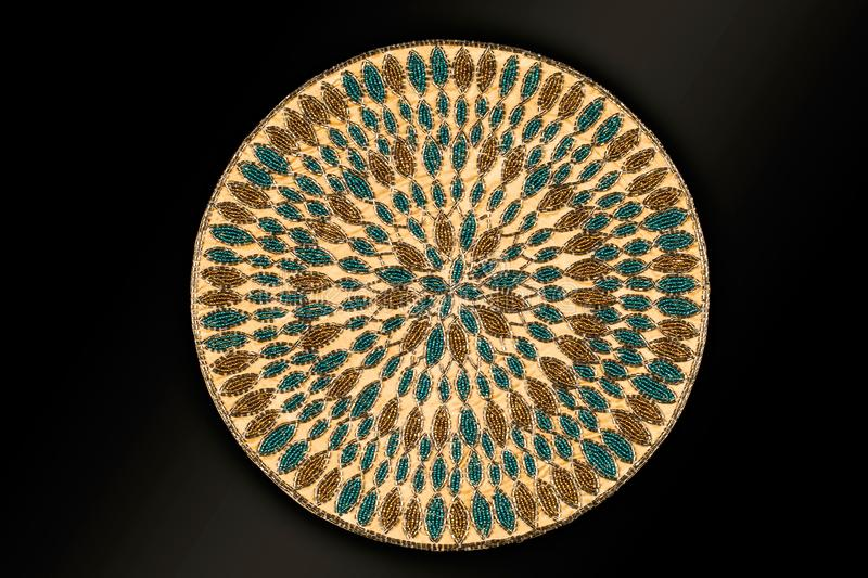 Arabic And Indian Round Gold Hand Beaded And Handmade Placemats. Table Runner Home Decorations Crafted Of Luminous Glass Beads Sewn To A Satin Fabric stock image