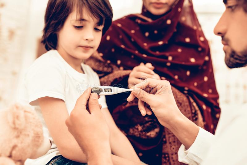 Arabic Male Doctor Examining Measuring Temperature. Child at the Pediatrician. Hospital Concept. Healthy Concept. Child Patient Visiting Doctor. Doctor royalty free stock images