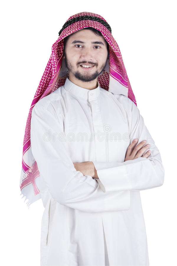 Arabic man folded his arms in studio stock photography