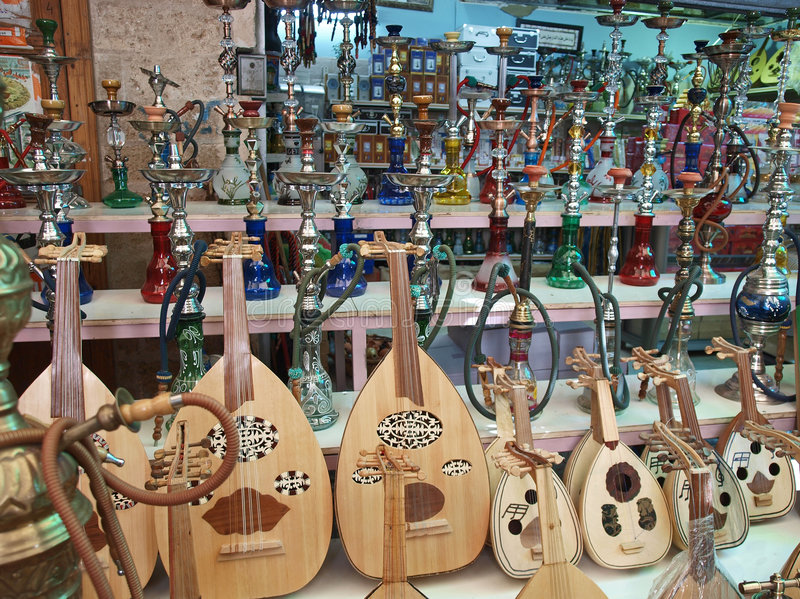 Arabic Oriental market shop. Selling water pipes hookah and oud royalty free stock photos