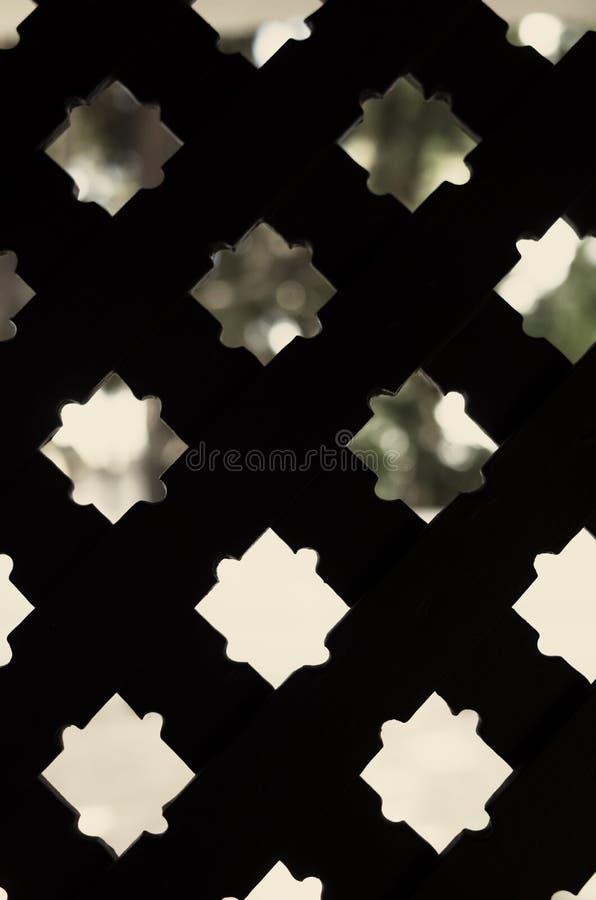 Arabic pattern in Alcazar de Sevilla. See through an arabic pattern in Real Alcazar in Sevilla, Spain royalty free stock photography