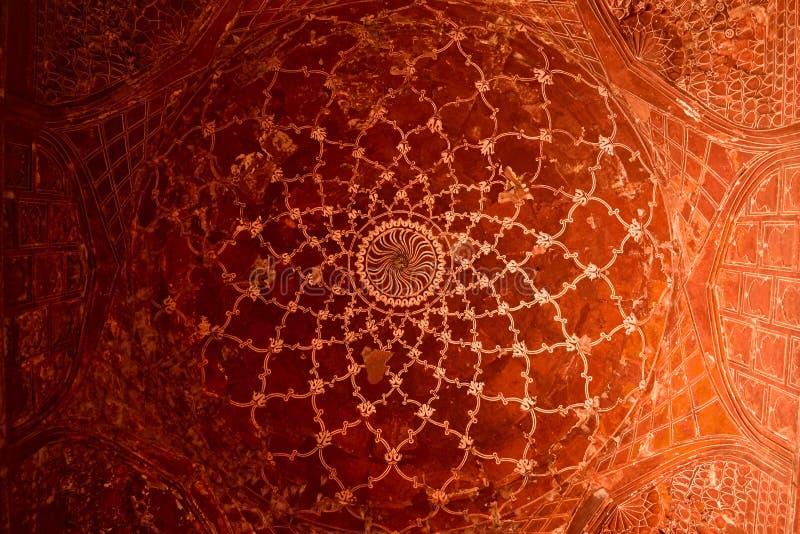 Arabic pattern on a ceiling. Agra, Uttar Pradesh, India - April, 2014: Arabic pattern on a ceiling. Abstract Islamic pattern in a mosque of Taj Mahal complex stock images