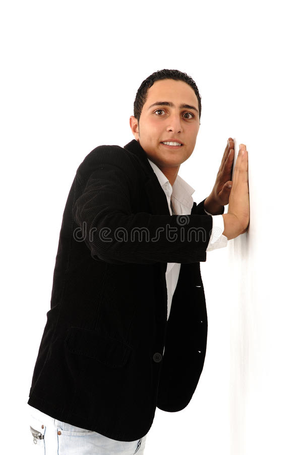 Arabic student leaning against the wall