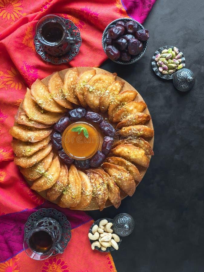 Arabic sweets. Arabian Qatayef. Cookies of El Fitr Islamic Feast. Ramadan food background.  stock images