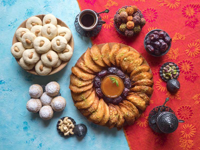 Arabic sweets. Arabian Qatayef, Ghorayeba sweets and Egyptian cookies `Kahk El Eid`. Cookies of El Fitr Islamic Feast. stock photography