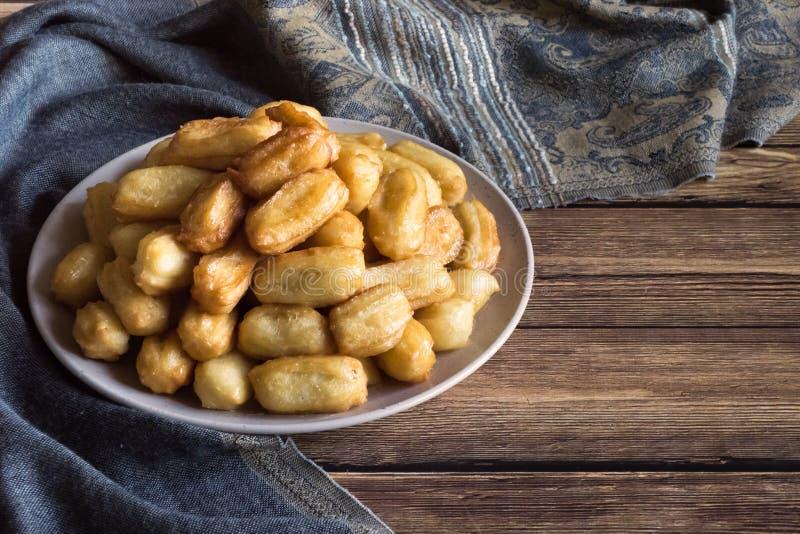 Awama - Arabic sweets celebration Eid Ramadan. Arabic sweets celebration Eid Ramadan. Awamatulumba - arabian syrup-soaked fried sponge honey royalty free stock image