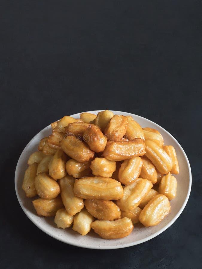 Arabic sweets Tulumba, celebration Eid Ramadan. Arabic sweets celebration Eid Ramadan. Tulumba- arabian syrup-soaked fried sponge honey royalty free stock photo