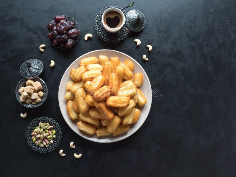 Arabic sweets Tulumba, celebration Eid Ramadan. Arabic sweets celebration Eid Ramadan. Tulumba- arabian syrup-soaked fried sponge honey royalty free stock photos