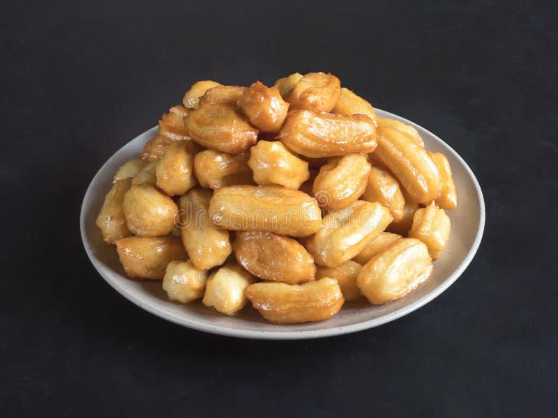 Arabic sweets Tulumba, celebration Eid Ramadan. Arabic sweets celebration Eid Ramadan. Tulumba- arabian syrup-soaked fried sponge honey royalty free stock image